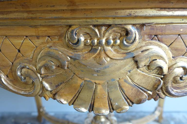 19th Century French Giltwood Table with Center Urn and Shell Design