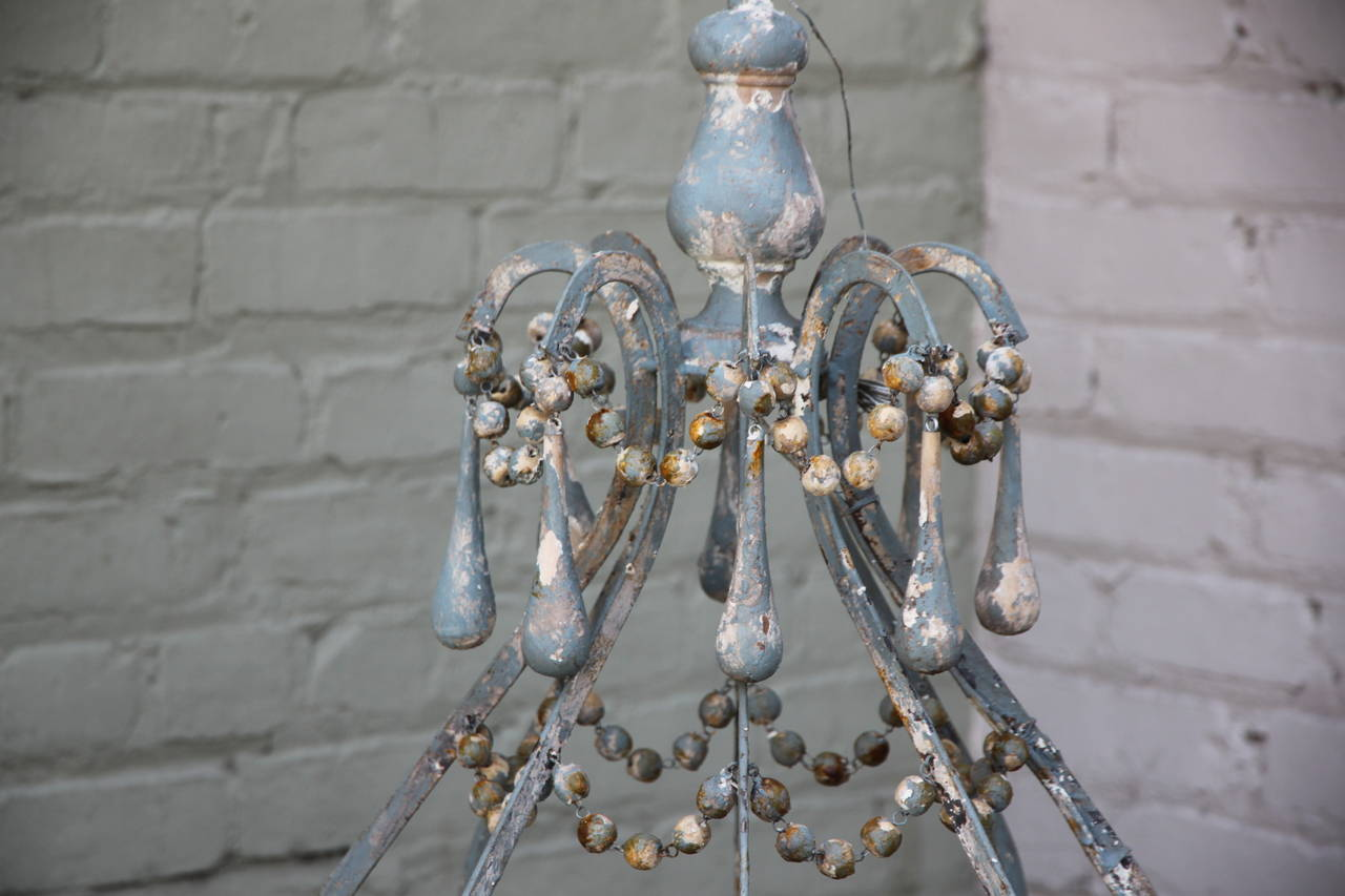Iron And Wood Beaded Eight Light Painted Chandelier