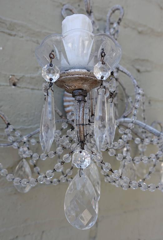 Pair of Silver Metal and Crystal Sconces