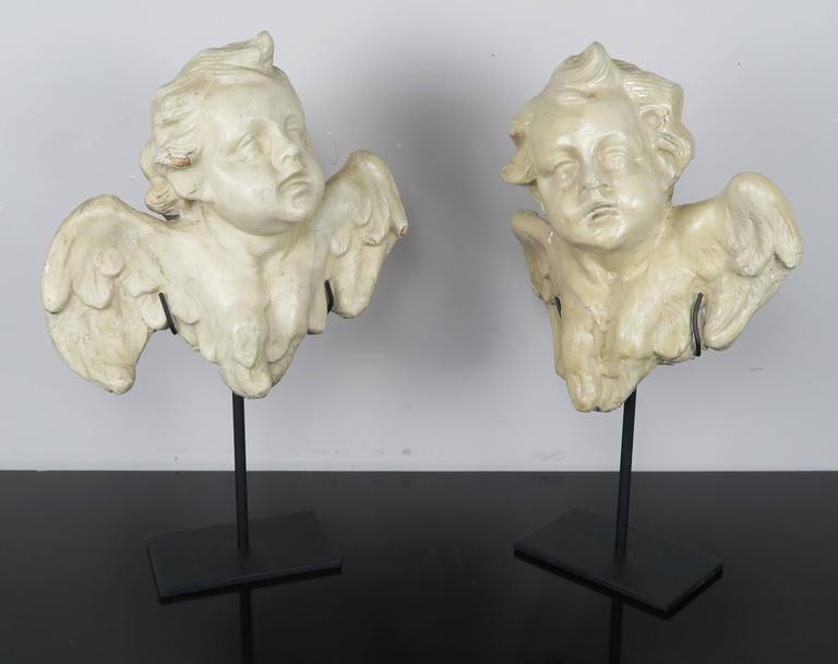 Pair of Papier Mâché Cherubs on Iron Bases