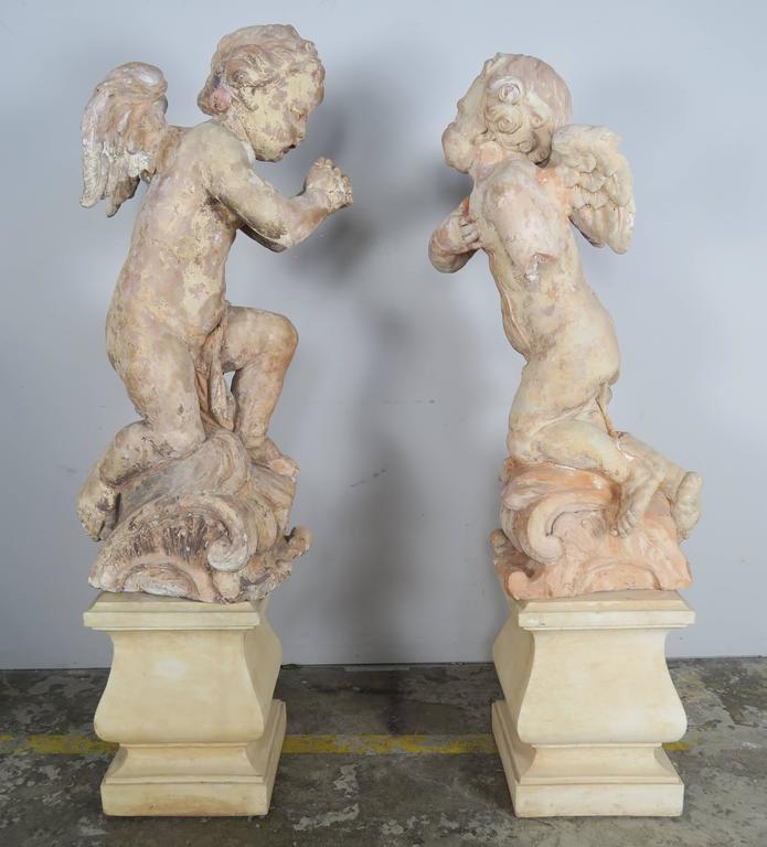 Pair of 18th Century Terra Cotta Cherubs by Claude Clodion