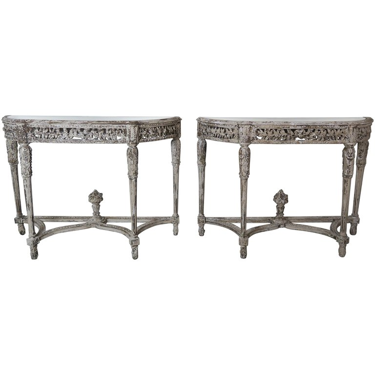 Pair of French Painted Louis XVI Style Carved Consoles, Antiqued Mirrored Tops $15,000