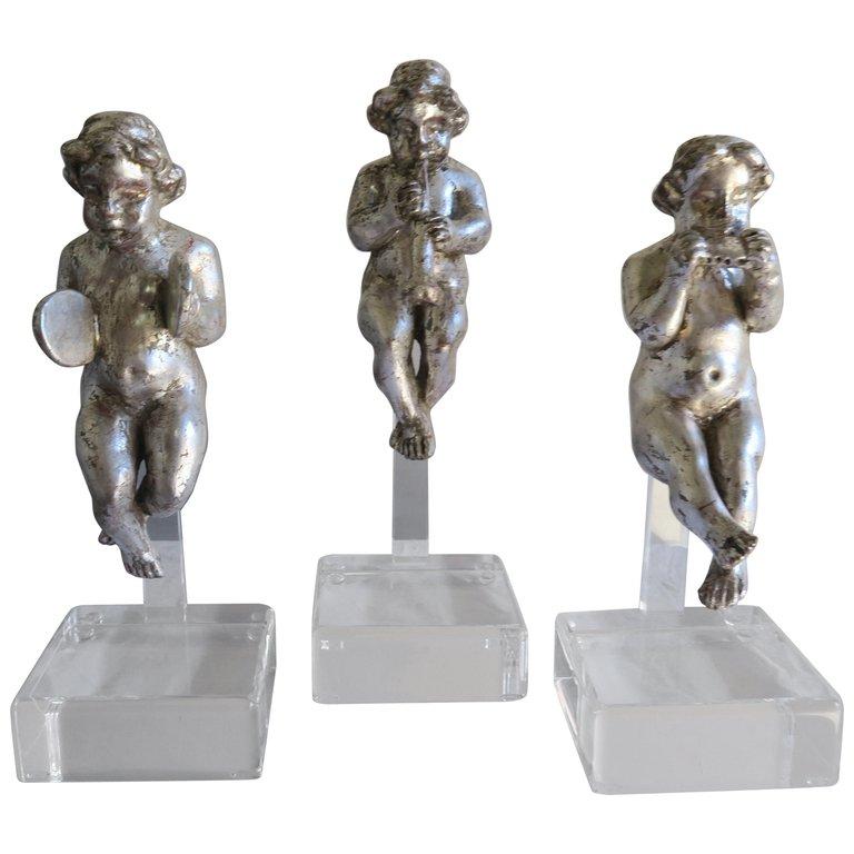 Set of Three Silver Gilt Musical Cherubs on Lucite Bases $1,800