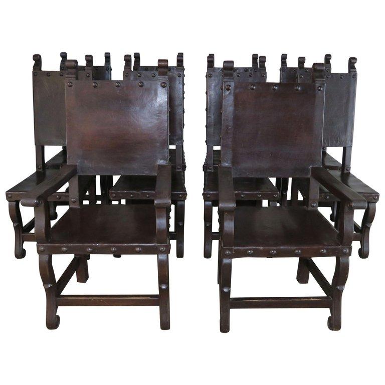 Set of Ten Spanish Walnut Leather Dining Chairs, circa 1940s $9,500