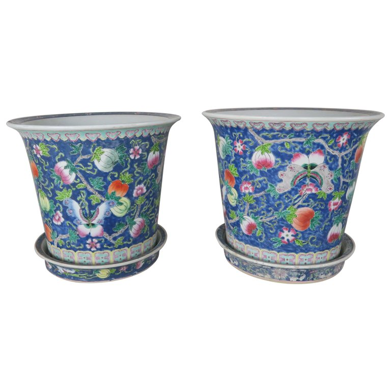 Pair of Hand Painted Ceramic Pots $750