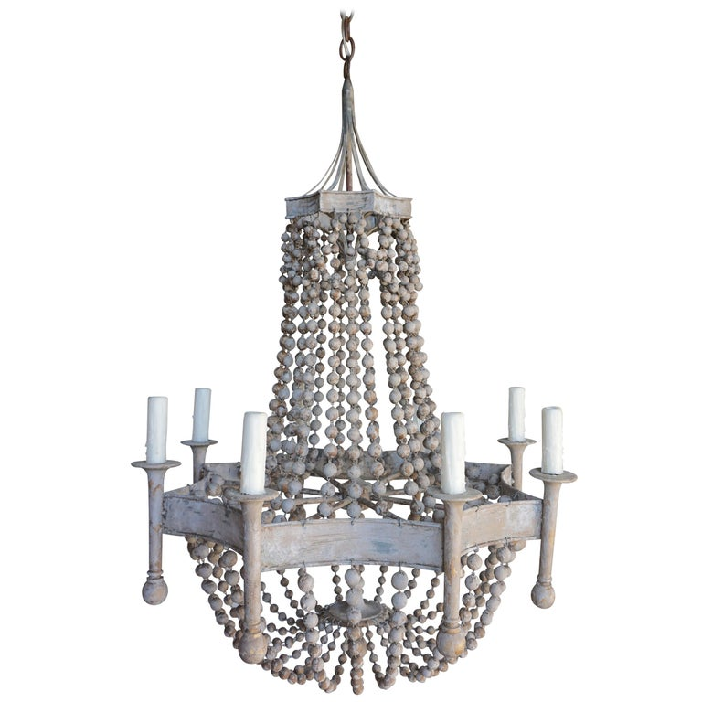 Eight Light Painted Wood Beaded Chandelier $3,800
