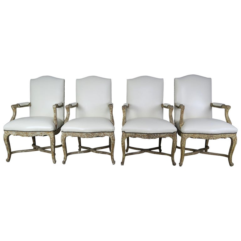 Set of Four Leather Upholstered Painted French Armchairs $7,500
